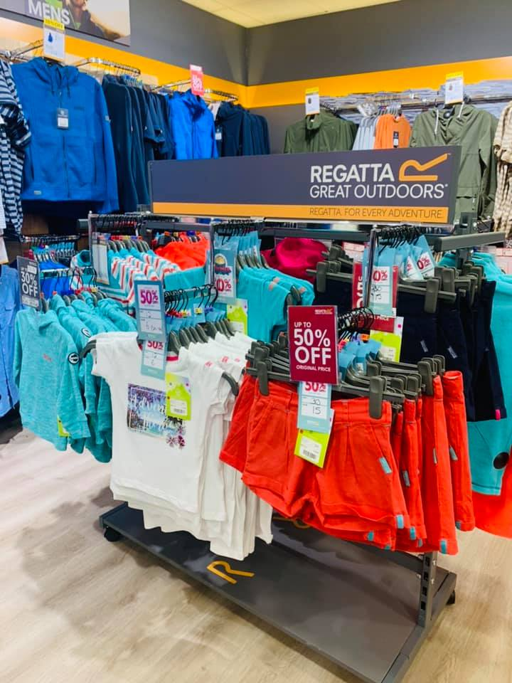 Rack of outdoor clothes in the Regatto store